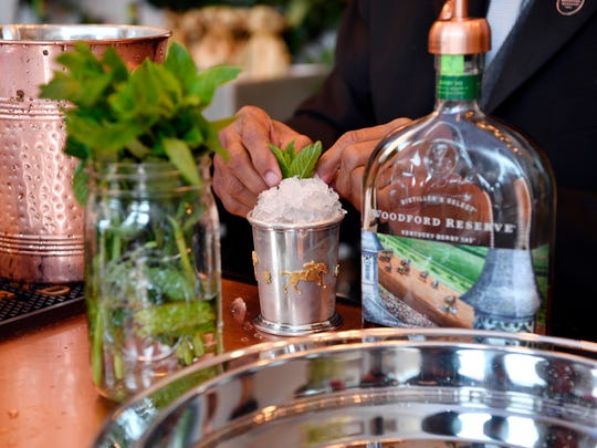 Bartender Ron Jones makes a thousand dollar mint julep
