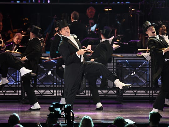 Kevin Spacey performs in the opening number of the
