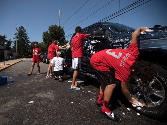 Car wash at Fair Lawn High School for injured Fair