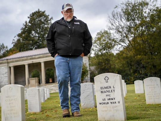 Nashville Army veteran J.T. Cooper reflects as he walks the grounds at the Nashville National Cemetery in Madison on Friday, Oct. 27, 2017.