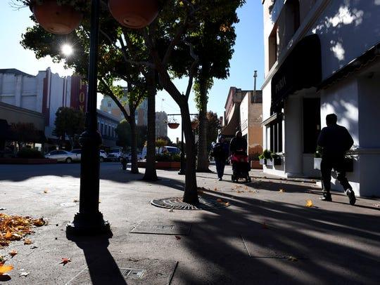 People walk through Salinas' Oldtown one morning.