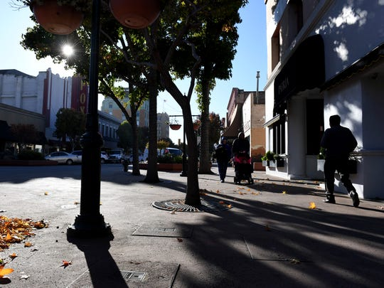 People walk through Salinas' Oldtown one morning.