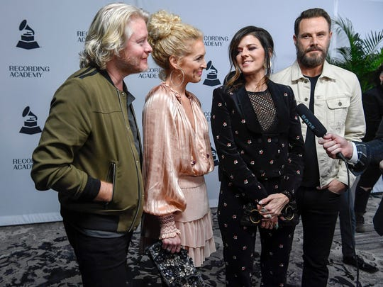 Members of Little Big Town talk with reporters as they walk the red carpet for the Grammy nominee party at Loews Vanderbilt Hotel in Nashville on Jan. 11, 2018.