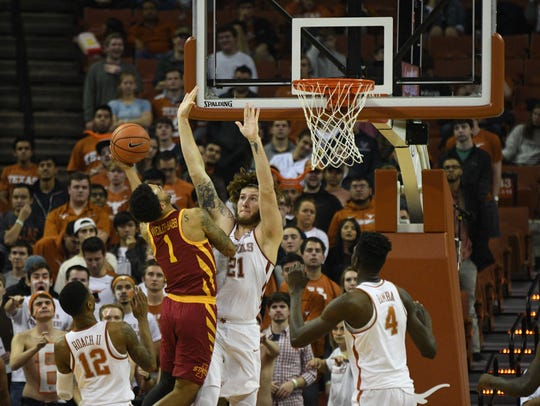 Iowa State guard Nick Weiler-Babb shoots against Texas forward Dylan Osetkowski during their game Monday in Austin, Texas.