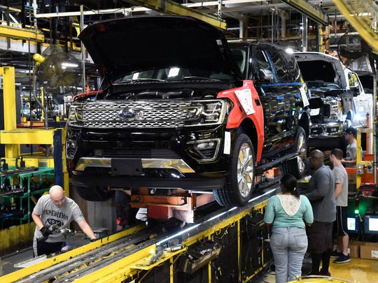 UAW members are concerned about safety during the pandemic. Here, workers assemble Ford trucks at the Ford Kentucky Truck Plant in Louisville, Ky. in October 2017.