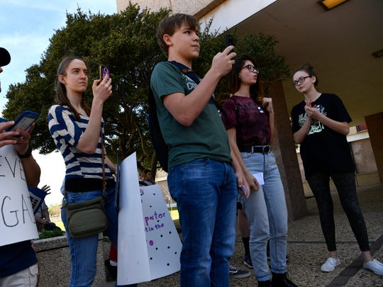Speakers wait their turn during Saturday's March for Our Lives at Abilene City Hall March 24, 2018. Led by young people, groups from cities across the nation marched to demonstrate against gun violence and to call for stricter gun laws.