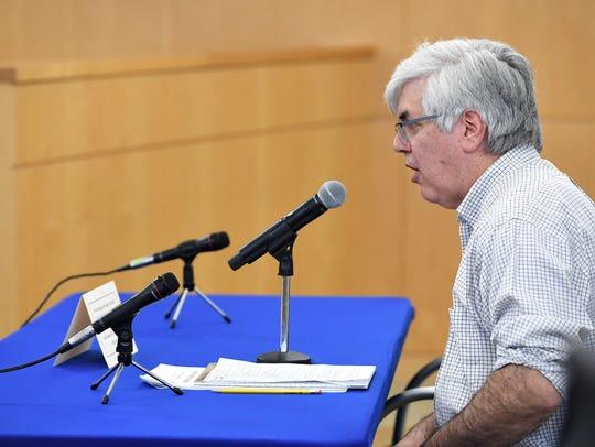 Adam Brown, of Englewood, talks with (not pictured)Senators