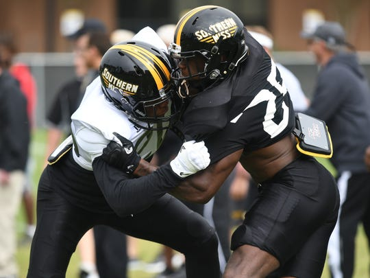 Southern Miss defensive back Tyler Barnes (25) tries