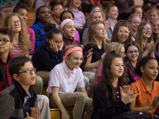 Helfrich Park STEM Academy middle school students watch