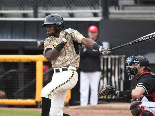Southern Miss center fielder Fred Franklin makes contact with a Western Kentucky pitch during Saturday's home game.