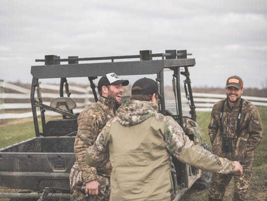 Predators forward Mike Fisher (left) laughs while hunting