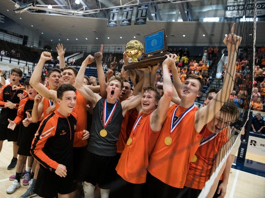 The Northeastern Bobcats hoist the PIAA trophy after beating the Manheim Central Barons in four games in Penn State's Rec Hall, Saturday, June 9, 2018. The Bobcats have won six-straight state titles. Saturday, June 9, 2018. The Northeastern Bobcats beat the Manheim Central Barons in four games to earn its sixth-straight PIAA title.