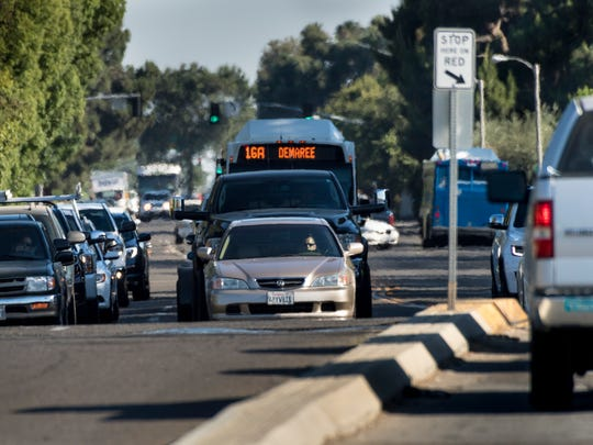 Traffic waits for lights to turn at Demaree Street