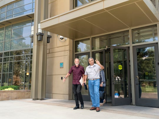 Kevin Northcraft, left, and Mike Jamaica leave court