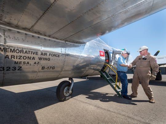 Flight Load Master David Gilham, right, helps Howard