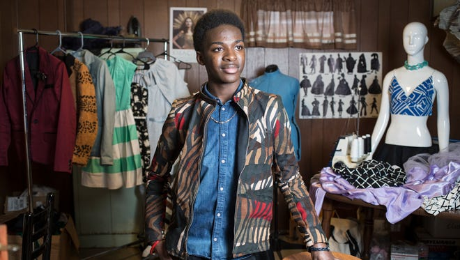 duPont Manual student and 16-year-old clothing designer, Zach Lindsey, poses for a portrait in his basement studio.