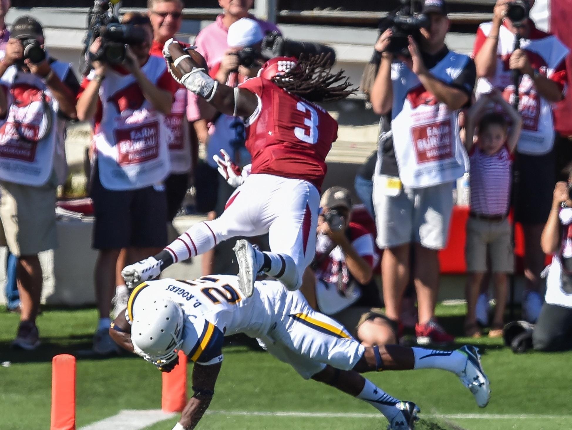 Toledo strong safety Delando Johnson attempts to keep Arkansas' Alex Collins out of the end zone during last week's game in Little Rock. Toledo pulled off a shocking 16-12 upset.
