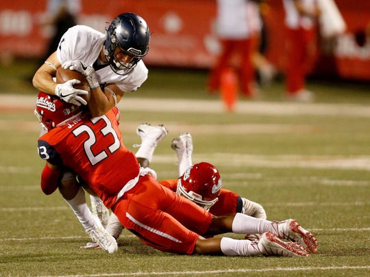 Fresno State defensive back Juju Hughes stops Nevada's McLane Mannix short of a first down during their game Saturday.