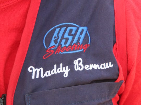 Madelynn Bernau, a member of the USA Shooting team, wears a team vest during a practice session at the Burlington Conservation Club.
