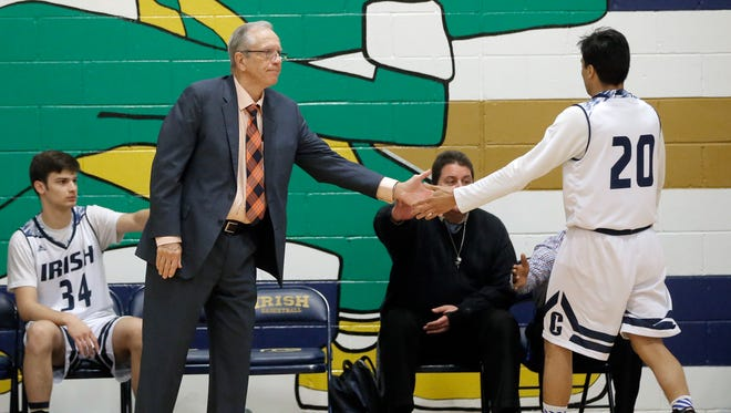 Cathedral head basketball coach Tony Harper is closing in on his 1000th win. Above, Harper leads his team against Faith Christian for his 998th win.