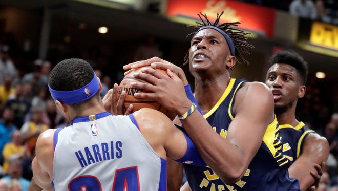 Indiana Pacers center Myles Turner, front right, and Detroit Pistons forward Tobias Harris (34) vie for a jump ball in the final minute of the second half of an NBA basketball game in Indianapolis, Friday, Dec. 15, 2017.
