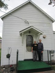 Lois and LeRoy Warnert in front of the original St.