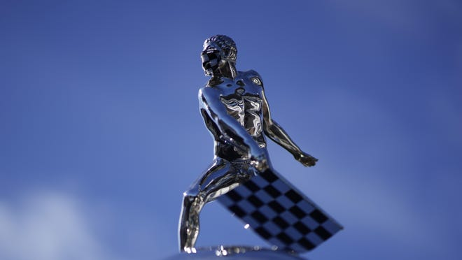 The top of the Borg-Warner Trophy complete with checkered flag mask, is shown on the start/finish line before the final practice session Friday for the Indianapolis 500 on Sunday afternoon at Indianapolis Motor Speedway.