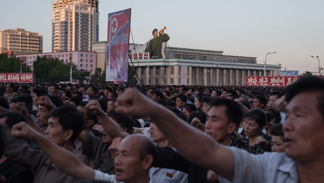 Participants of a mass rally shout slogans as they gather on Kim Il-Sung sqaure in Pyongyang on Sept. 23, 2017.Tens of thousands of Pyongyang residents were gathered in the capital's Kim Il-Sung square to laud leader Kim Jong-Un's denunciation of President Donald Trump.