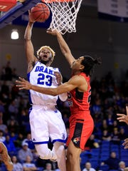 Ore Arogundade of Drake goes up for a dunk as Madison