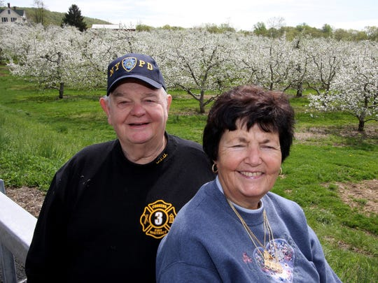 Niles and Jan Davies of the Davies Farm have an exceptional apple bloom April 30, 2009 this year, following a short crop last year. The Davies and other area farmers are hoping for a great crop of apples this year after a pretty poor season last year.( Kathy Gardner / The Journal News )