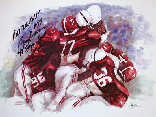 This watercolor is by former Indianapolis Colts linebacker Barry Krauss  depicting the famous goal-line tackle where he helped stop a touchdown attempt in the Alabama vs Penn St. securing the Alabama victory in the 1979 Sugar Bowl. He is #77. Penn State quarterback Chuck Fusina tried to dive over Alabama for the touchdown, but failed to make it.
