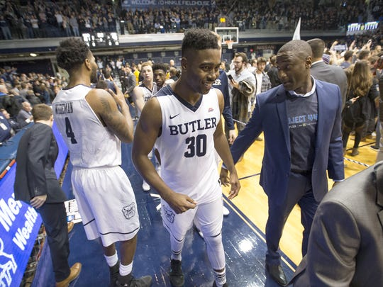 Butler Bulldogs forward Kelan Martin (30) smiles as he walks off the court following their game at Hinkle Fieldhouse Saturday, Dec. 30, 2017. The Butler Bulldogs defeated the Villanova Wildcats 101-93.