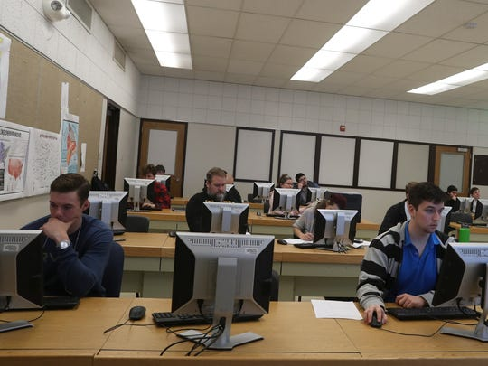 Students at Shasta College work during an Introduction to Computer Science class Wednesday at the college in Redding.