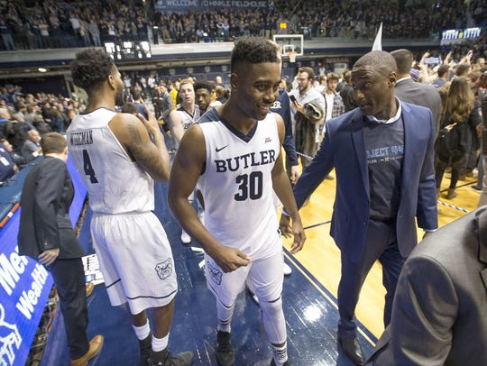Butler's Kelan Martin smiles as he walks off the court