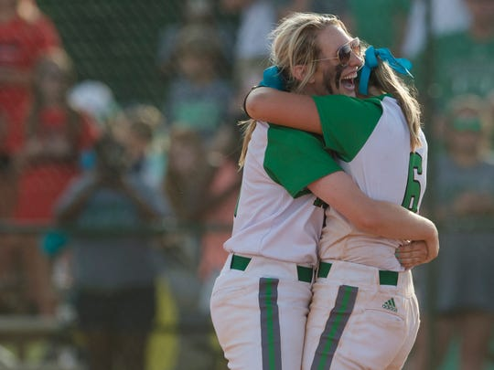 Brantley's Olivia Jones, left, smiles as she embraces Brantley's Hannah Sims after the AHSAA State Softball Tournament Final game between Brantley and Sumiton Christian on Thursday, May 17, 2018, in Montgomery, Ala. Brantley defeated Sumiton Christian 5-1.