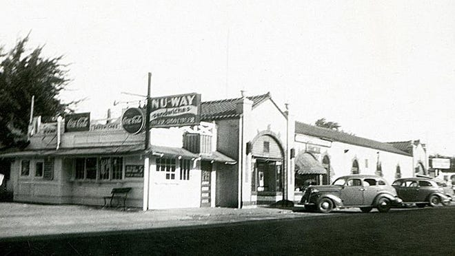In 1932, Robert Rasmussen opened the first Nu-Way Sandwich Shop in Hutchinson at 315 N. Poplar, seen in this photo in 1937. This shop was just south of the Fourth & Poplar Shops which were built in 1926.
