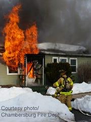 Firefighters battle a house fire Sunday, Jan. 30, 2016