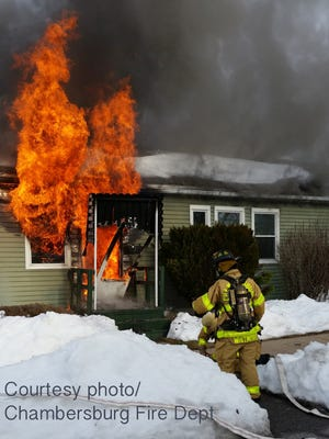 Firefighters battle a house fire Sunday, Jan. 30, 2016 at Redwood Street, Chambersburg. The homeowner was able to escape the fire. No injuries were reported.