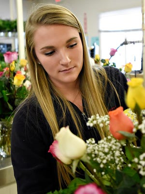 Kylie McCall, of Royers Flowers and Gifts, builds a Dozen Rainbow Rose Arrangement at the store on Loucks Road in York City Tuesday, Feb. 9, 2016. (Dawn J. Sagert - The York Dispatch)