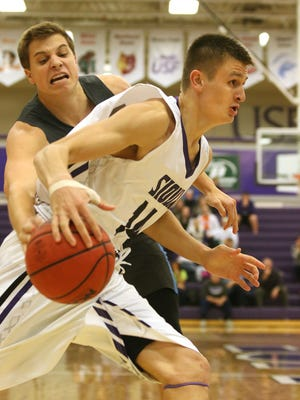 SIOUX FALLS, SD - DECEMBER 5:  Tom Aase #14 from the University of Sioux Falls tries t get a step past the reach of Jimmy Roth #10 from Upper Iowa in the first half of their game Friday night at the Stewart Center.  (Photo by Dave Eggen/inertia)