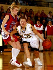 Sarah Black, left, as a player for Union City's girls basketball team in 2002, helped the Indians win four straight sectional titles. She will be leading the Indians to the state championship game Saturday at Bankers Life Fieldhouse.