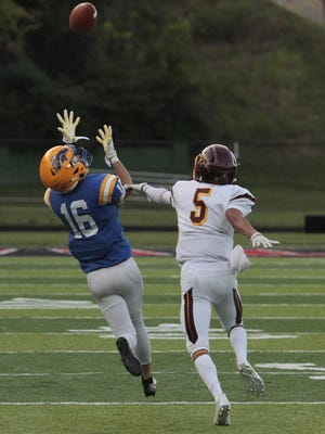 Aubrey Posey of NewCath has a ball roll off his fingertips.  The Cooper Jaguars travel to take on the Newport Catholic Thoroughbreds at Newport Stadium Friday Night, August 25th.