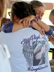 Bianka Landavazo (right) hugs Alani Darkow Saturday