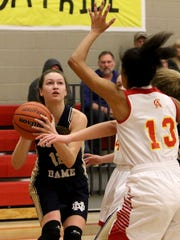 Notre Dame's Reagan Macha looks to the basket in the
