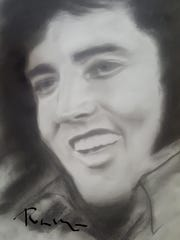 A portrait of Elvis Presley done by Robin Shoup Wilson.