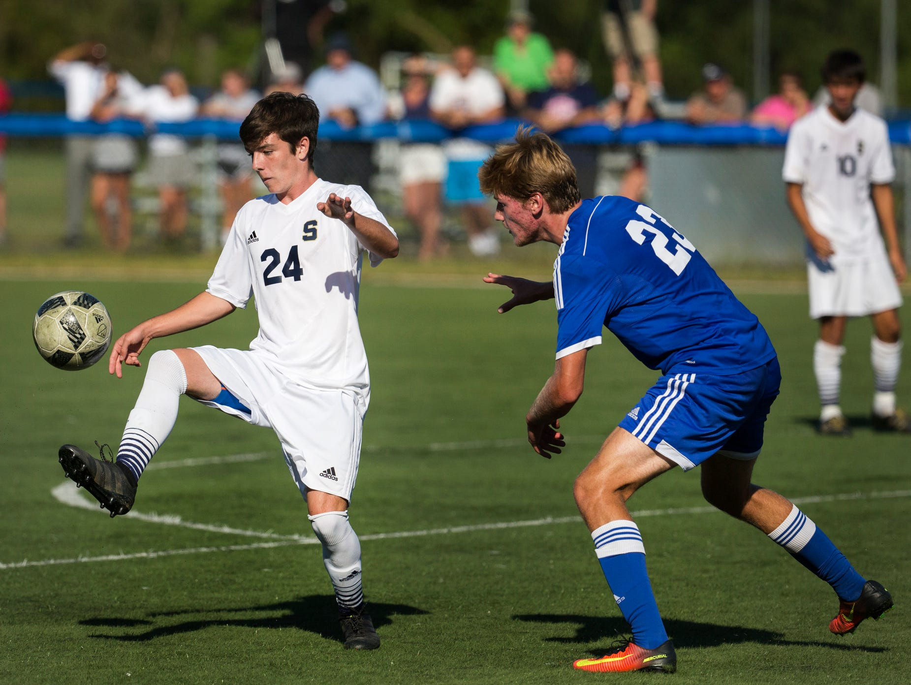 Salesianum's John Leonard (No. 24) traps the ball in front of Wilmington Charter's Rhys Newcombe (No. 23) in the first half of Salesianum's 1-0 win over Wilmington Charter at the Hockessin Soccer Club in Hockessin on Thursday afternoon.