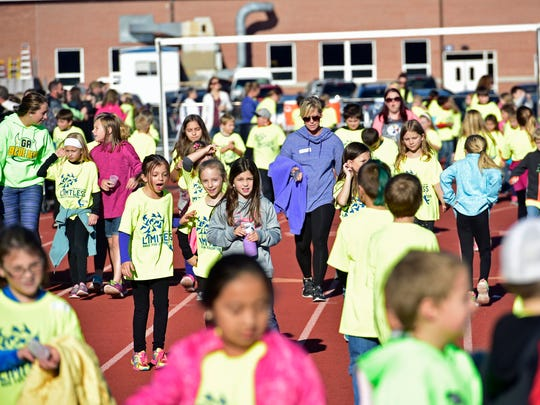 The annual Race for Education event, where students are sponsored to walk around the school track to raise money for Greencastle elementary and primary schools.