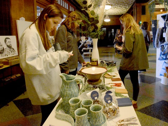 Savannah Street, Madison Stafford and Ali Butler check out items at the Yule Tide Pop-Up Shop on Saturday, November 26 at the New Southern.