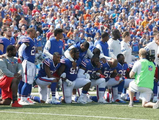 Members of the NFL's Buffalo Bills kneel in protest