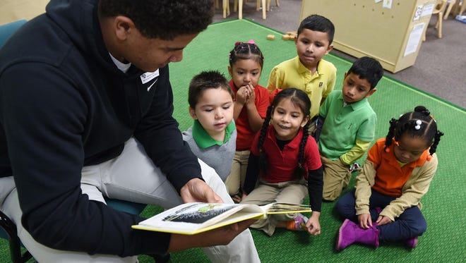 Brentwood Academy student Jordan McCoy reads to Whitsitt Elementary Pre-K students during a community outreach day on Feb 1.